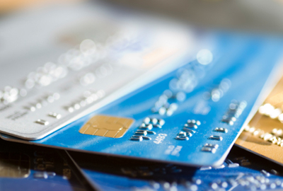 Pile of credit cards, narrow focus.